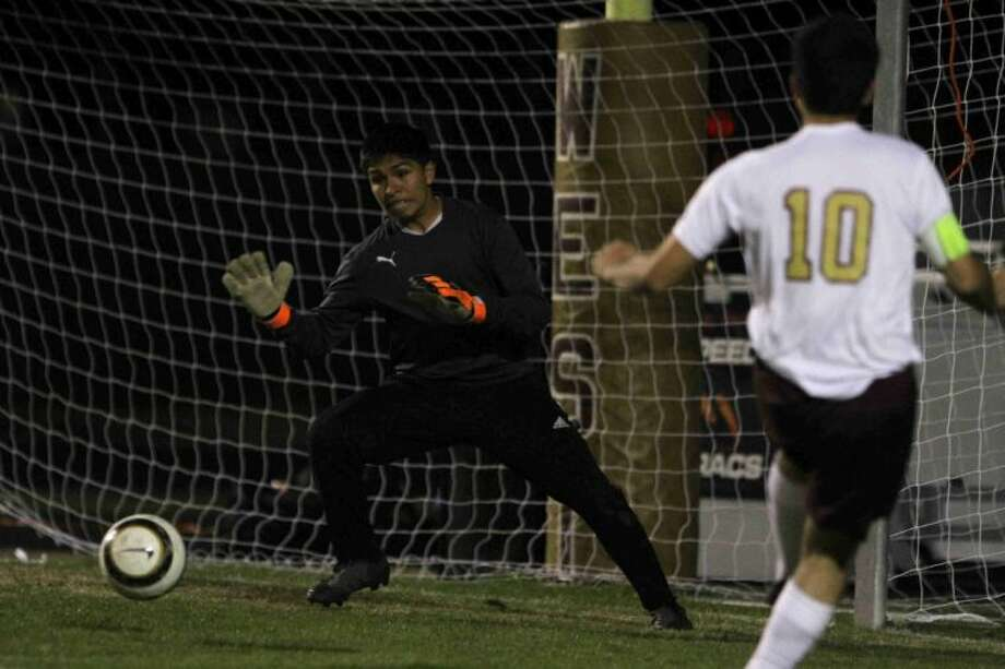 New Caney goalkeeper Cesar Chavez blocks a shot by Magnolia West's Jose Lopez on Friday at Magnolia West High School. To see this photo and others like it, visit HCNpics.com. Photo: Jason Fochtman