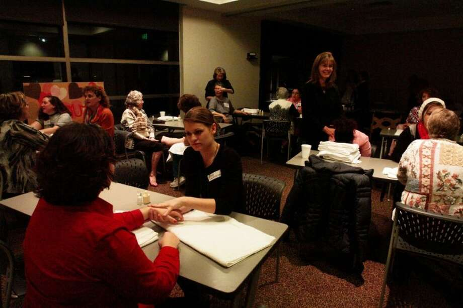"""Members of Breast Friends, a breast cancer support group at MD Anderson Regional Care Center in The Woodlands, gather for the second annual """"Pamper Me Night"""" Feb. 9 at St. Luke's The Woodlands Hospital. Members received massages, facials and makeovers."""
