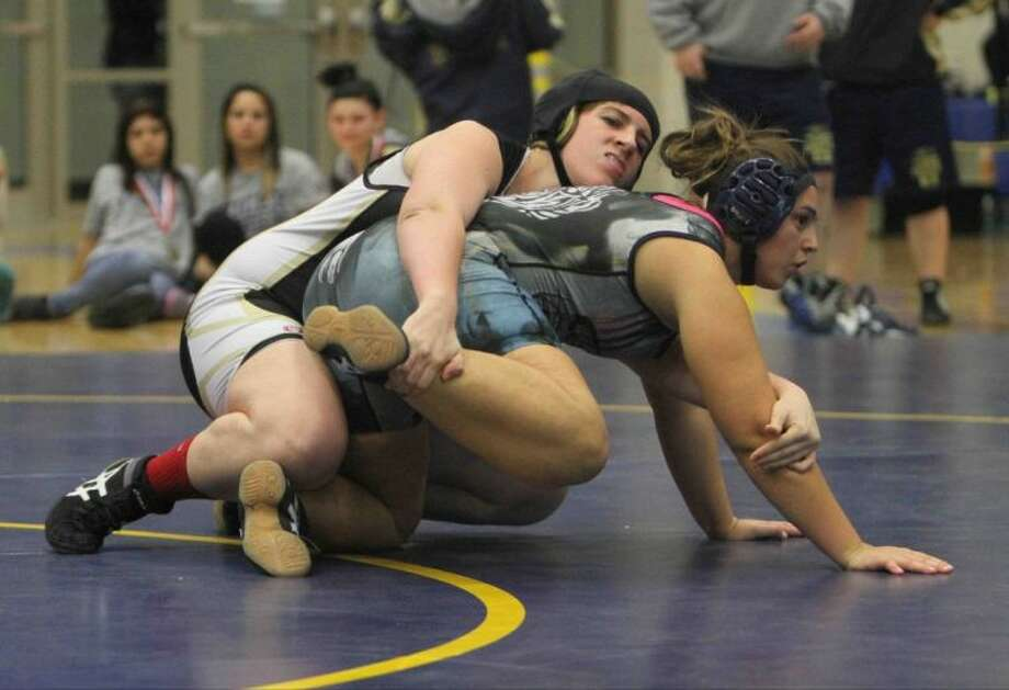 Conroe's Rebecka Winton wrestles Klein Collins' Tina Stegent during the District 9-5A Tournament on Friday at Klein High School. Winton pinned Stegent to become Conroe's first three-time district champion. To see or purchase this photo and others like it, visit HCNpics.com. Photo: Jason Fochtman