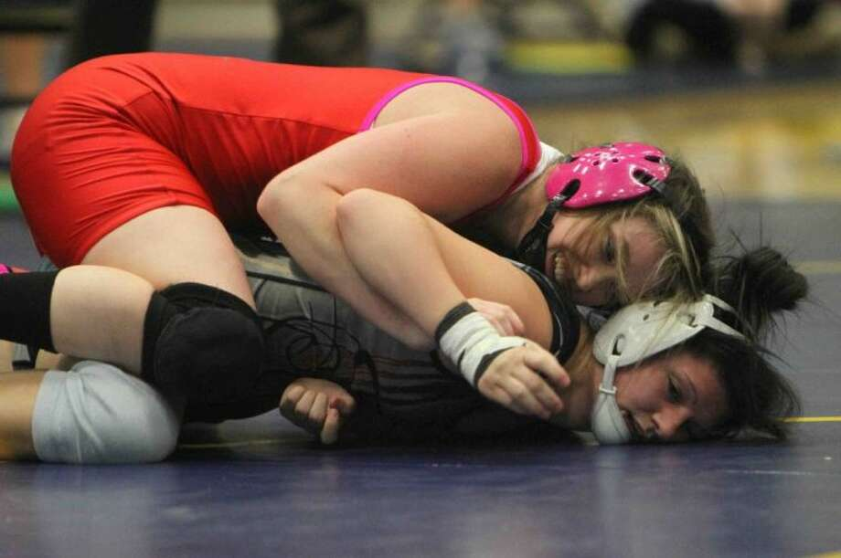 Lindsey Spjut of The Woodlands (in red) defeated Plano East's Luciana Schement in the Class 5A 119-pound state title match at the UIL wrestling championship on Saturday. Photo: Jason Fochtman