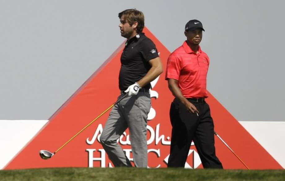 Robert Rock , the winner of Abu Dhabi HSBC Championship, left, and Tiger Woods prepare for the play on the 3rd hole during the final round of Abu Dhabi HSBC Championship, Sunday in Abu Dhabi, United Arab Emirates. Photo: Kamran Jebreili