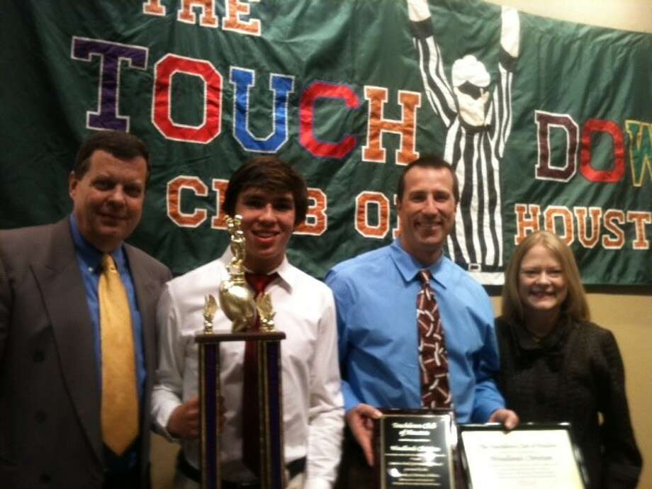 Pictured from left to right are Touchdown Club of Houston Executive Director Neal Farmer, The Woodlands Christian senior Cray Noah, Warriors coach Nate Sanford and Pam Lovett of Comerica Bank.