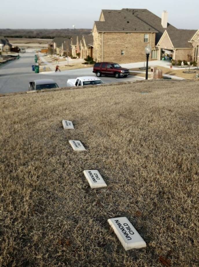 This Jan. 18, 2012 photo shows grave markers at the Herndon Cemetery, located in the middle of a new subdivision in McKinney. Photo: Vernon Bryant
