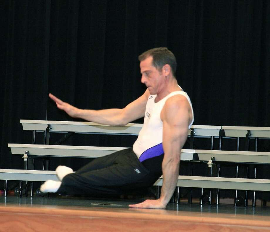 Motivational speaker Lloyd Bachrach shows off his pommel horse moves for students at Piney Woods Elementary Feb. 11. Bachrach visited each of the elementary schools in Splendora ISD to share his story.