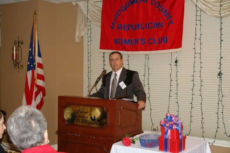 Montgomery County Attorney David Walker addresses the Montgomery County Republican Women at the club's meeting Thursday. Walker, who is retiring from office this year, explained the duties and services he provides the county's government with legal representation.