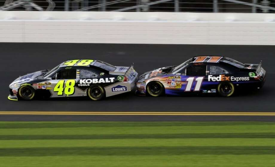 NASCAR driver Denny Hamlin stays on the bumper of Jimmie Johnson during a race practice session at Daytona International Speedway in Daytona Beach, Fla., on Friday.