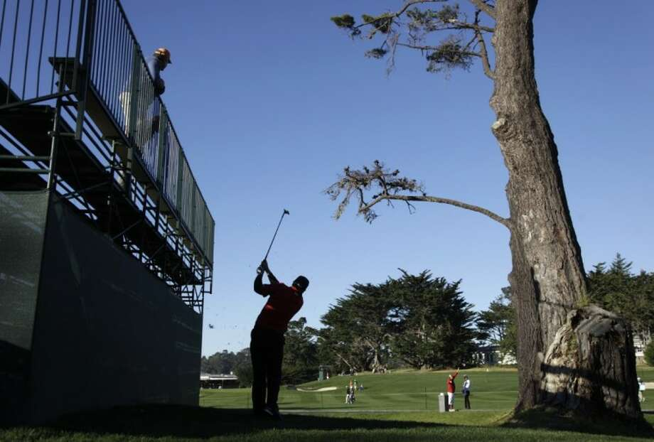 Steve Marino hits from off the fairway below a grandstand to the third green of the Pebble Beach Golf Links during the second round of the AT&T Pebble Beach National Pro-Am in Pebble Beach, Calif., on Friday.