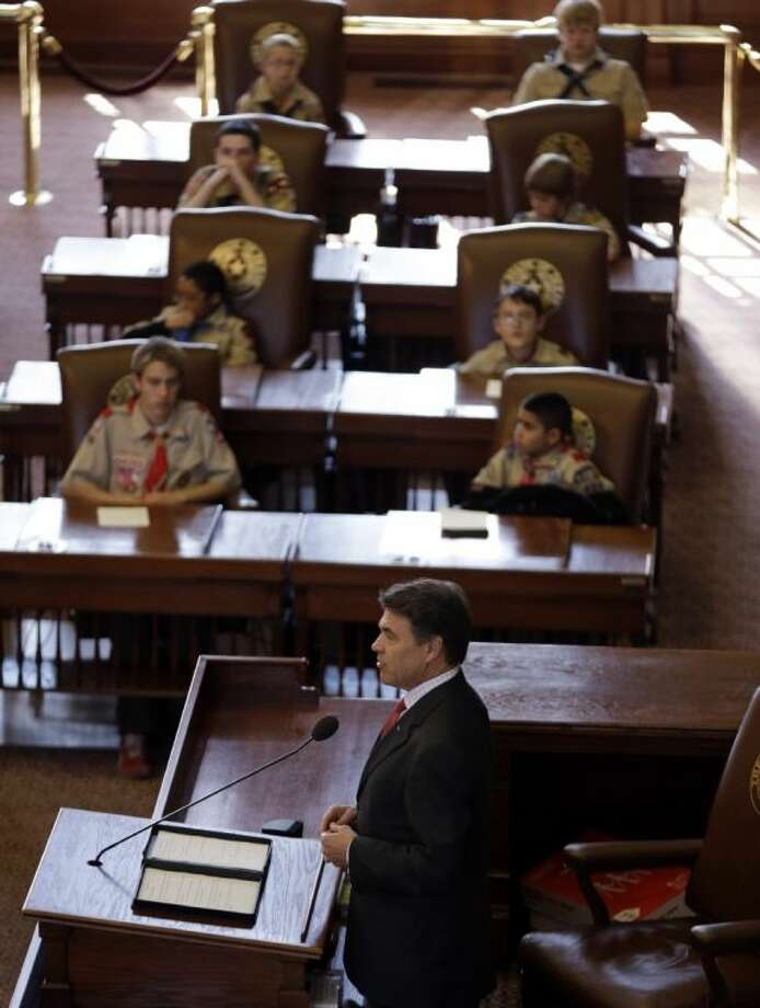 Gov. Rick Perry addressed the Boy Scouts during the Parade and Report to State in the House Chambers at the Texas State Capitol Saturday in Austin. Perry says he hopes the Boy Scouts of America doesn't move soften its mandatory no-gays membership policy. Photo: Eric Gay