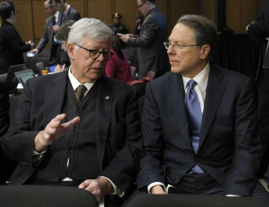 National Rifle Association President David Keene, left, talks with NRA Chief Executive Officer Wayne LaPierre, right, on Capitol Hill in Washington, Wednesday, Jan. 30, 2013, before the start of the Senate Judiciary Committee hearing on gun violence. Photo: Susan Walsh