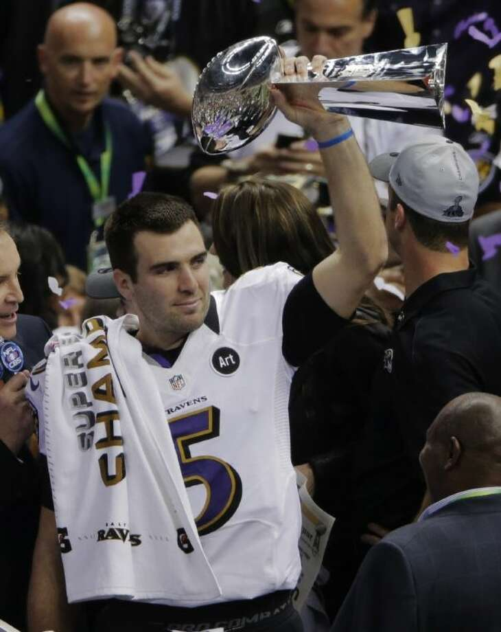 Ravens quarterback Joe Flacco holds the Vince Lombardi Trophy after his team defeated the 49ers 34-31 in the Super Bowl. Flacco was named the game's MVP.P Photo: Charlie Riedel