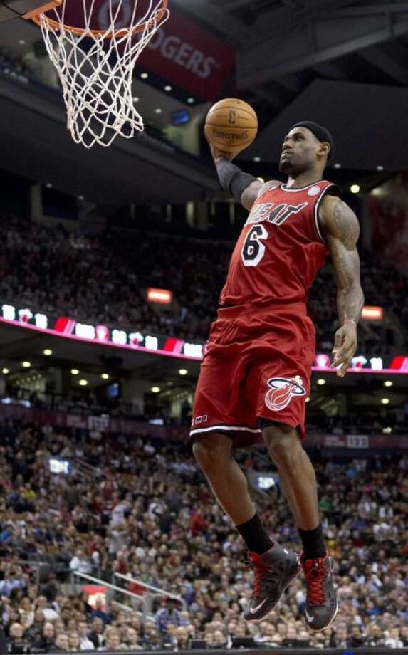 Miami Heat forward LeBron James soars in for a dunk in his team's win over the Raptors. Photo: Frank Gunn