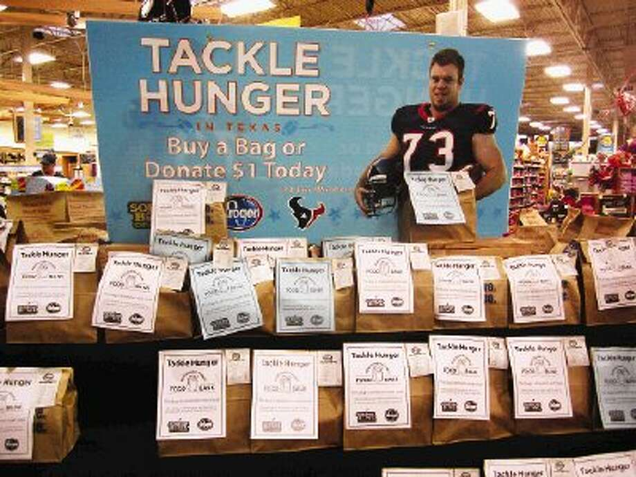 Local grocery stores have displays of pre-made food donation bags in support of the Souper Bowl of Caring benefiting the Montgomery County Food Bank.