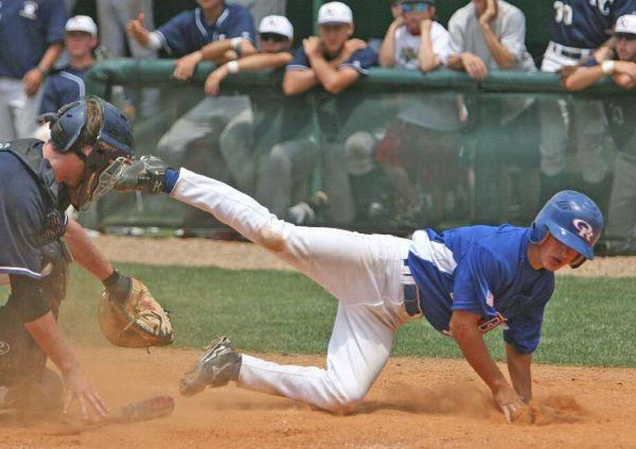 Oak Ridge's Connor Sarant scores from first on Preston Gustavsen's double Saturday, just getting past Klein Collins catcher Patrick Marsh on the play. / The Courier