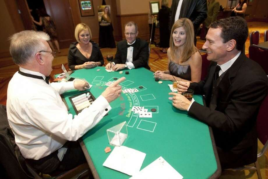 Byron and Leslie Ellis and Laura and Ron Folwell play Blackjack during the annual CASA gala Saturday at The Woodlands Waterway Marriott. Photo: Karl Anderson