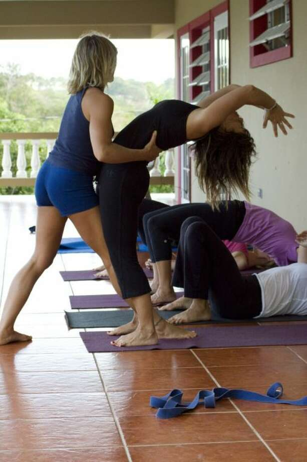 This March 2011 photo released by Just Love Photography shows a yoga session in Rincon, Puerto Rico, at a retreat created by Jessica Bellofatto of KamaDeva Yoga and Gina Bradley of Paddle Diva. The program is an example of active vacations tailored to travelers who value healthy lifestyles and new experiences. Photo: Evelyn O'Doherty