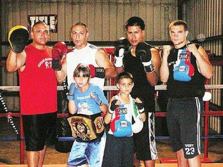 Montgomery County residents headed to the 2008 Ringside World Championships for amateur boxing are, top row, from left, coach James Reyna, Marty Martinez, Gustavo Gonzalez and Robbie McClimans; bottom row, Ashlyn Reyna and Fernando Garcia. Not pictured are Chris Dieterich, Jeff Gonzales Jr. and Jeff Gonzales Sr.