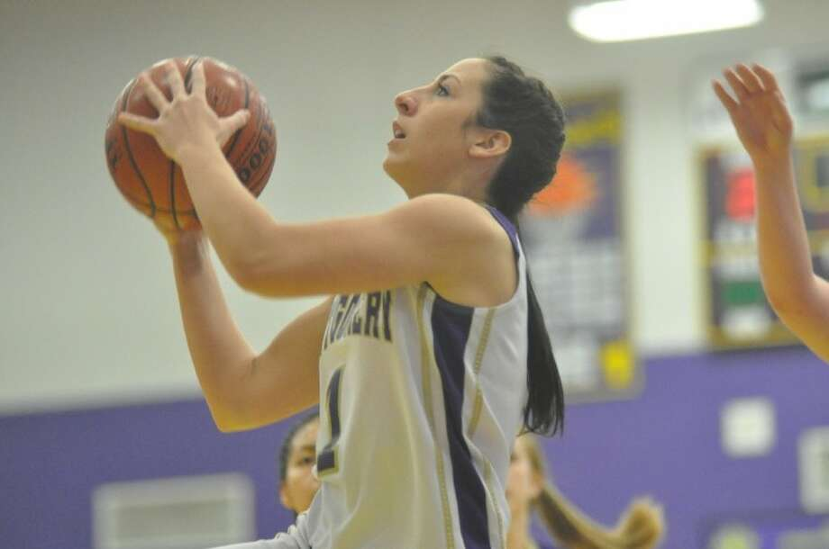 Montgomery's Tia Molnari goes up for a layup in Tuesday's District 17-4A win over Spring Woods at Montgomery High School. Photo: Keith MacPherson