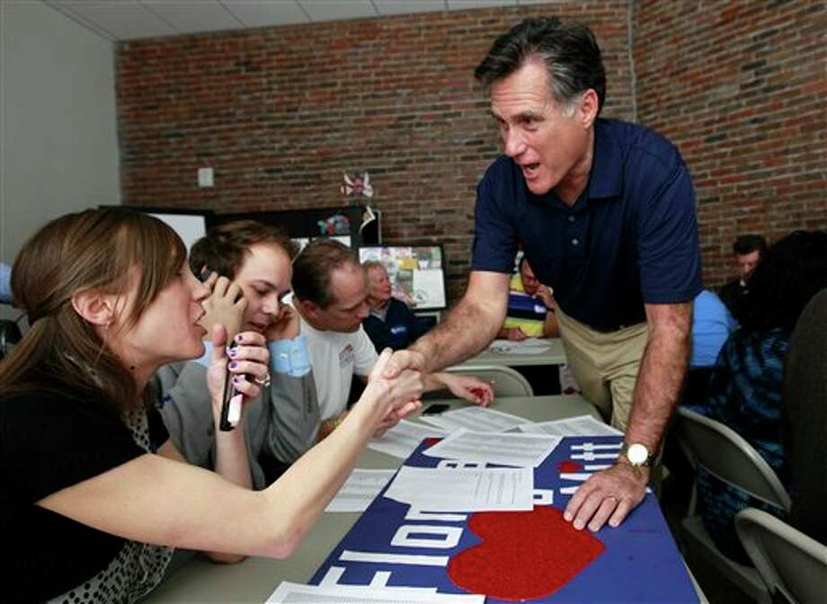 Republican presidential candidate, former Massachusetts Gov. Mitt Romney greets volunteers at his campaign office in Tampa, Fla., Tuesday, Jan. 31, 2012, during Florida's primary election day. (AP Photo/Charles Dharapak) Photo: Charles Dharapak / AP