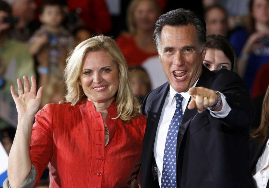 Republican presidential candidate, former Massachusetts Gov. Mitt Romney, stands with his wife Ann as he celebrates his Florida primary election win at the Tampa Convention Center in Tampa, Fla., Tuesday. Photo: Charles Dharapak