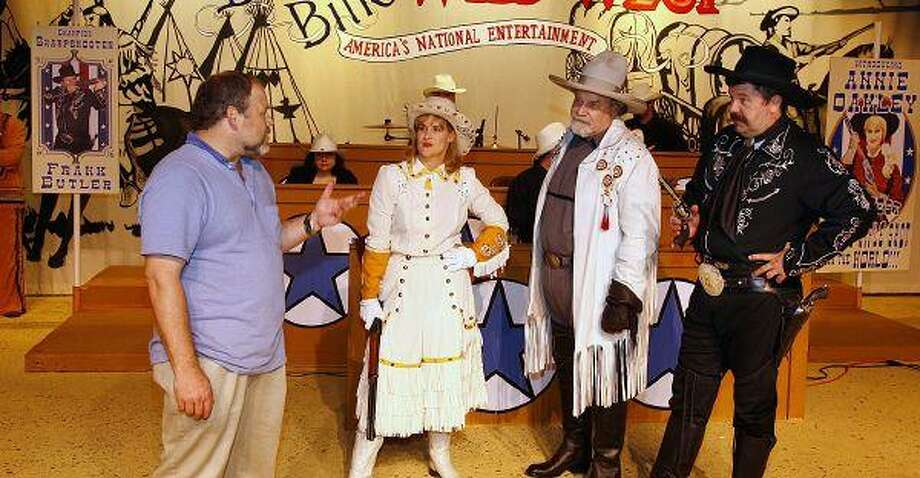 """From left, Travis Bryant, director of """"Annie Get Your Gun,"""" works with Kim Bryant, Jeff Elkins and Jeffrey Baldwin."""