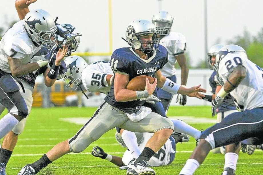 College Park quarterback Zach Wright on the run last season against Lamar Consolidated at Woodforest Bank Stadium. Wright signed on Wednesday a national letter of intent to play for the Rice University Owls. Photo: Joseph Buvid