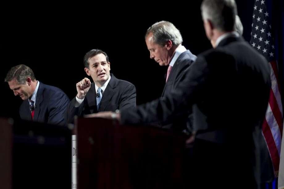 Texas solicitor general Ted Cruz, left, responds to Lt. Gov. David Dewhurst during a debate in Austin. Photo: Laura Skelding