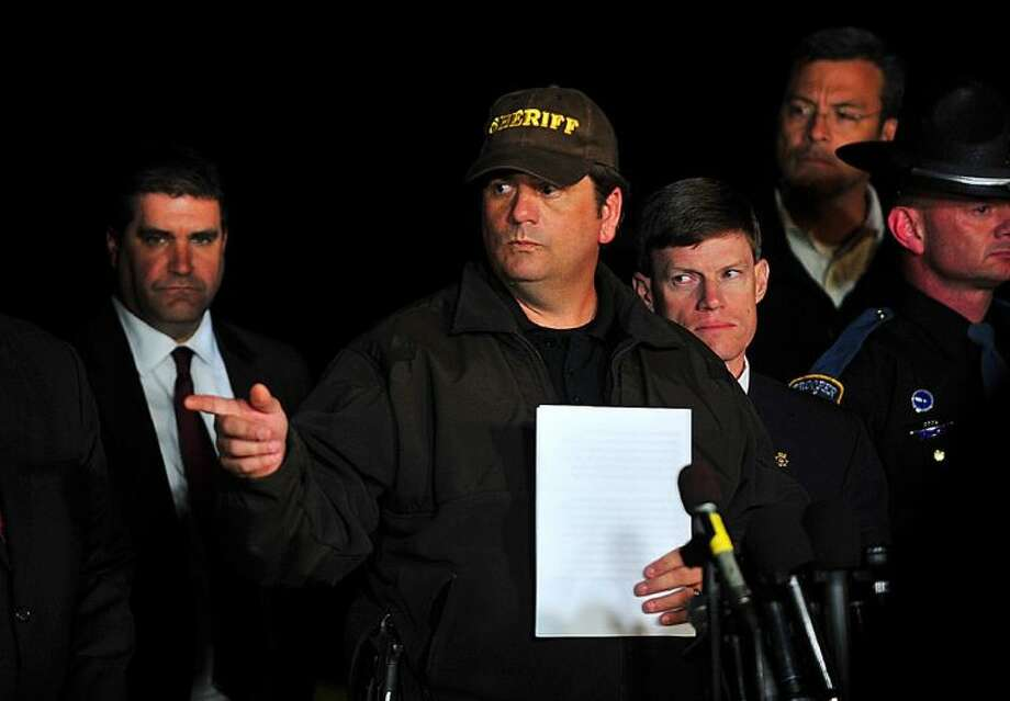 Dale County Sheriff Wally Olsen answers questions from the media about the close of the hostage crisis during a news conference late Monday in Midland City, Ala. Authorities stormed an underground bunker Monday in Midland City, freeing the 5-year-old boy and leaving his captor dead after a week of fruitless negotiations that left authorities convinced the child was in imminent danger. Photo: Jay Hare