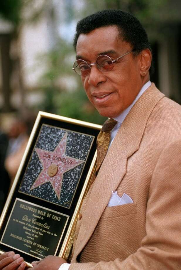 "In a Feb. 27, 1997 file photo, television producer Don Cornelius holds a plaque on the Hollywood Walk of Fame after the unveiling of his star in Los Angeles. Cornelius, creator of the long-running TV dance show ""Soul Train,"" shot himself to death Wednesday morning at his home in Los Angeles, police said. He was 75. Photo: JOHN HAYES"