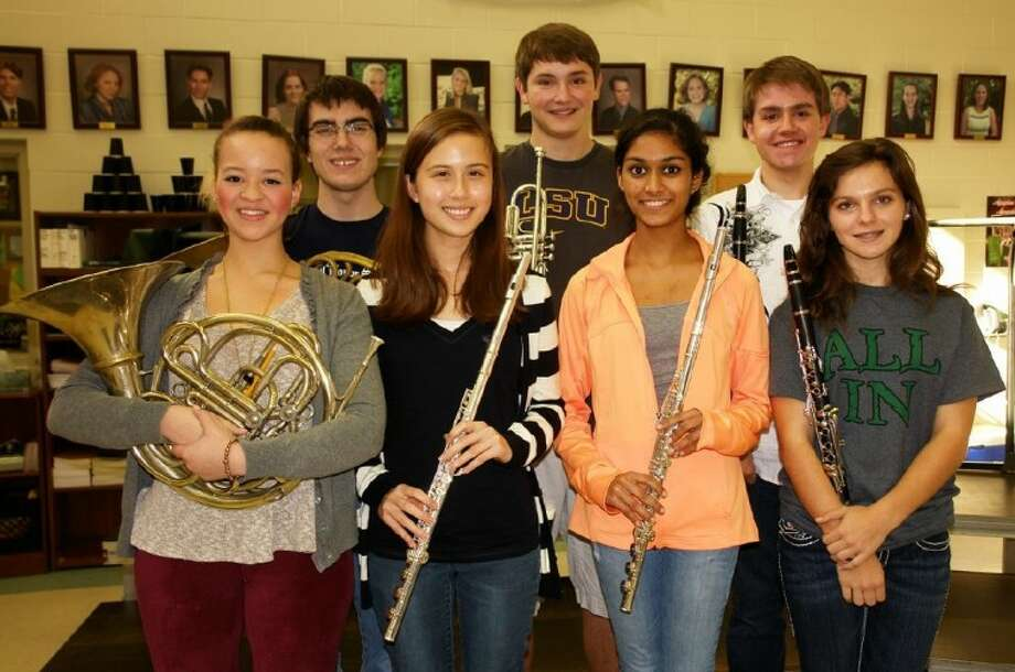 Seven musicians from The Woodlands High School earned a spot in the 5A All-State Band. Pictured, from left, are Alyx Henderson, French horn; Scott Leger, French horn; Hannah Criswell, flute; Alec Keane, cornet/trumpet; Nikita Patel, flute; Anthony Dapoz, clarinet; and Taylor Brodeur, clarinet. Photo: Staff Photo By Kassia Micek