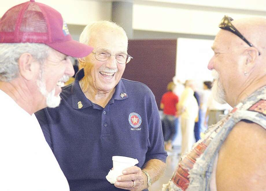 "Honor Flight participant, Jim Alexander, center, shared stories with Lou Freitas, left, and Rich ""Boomer"" Ford, right, after watching a 30-minute video with clips from the Lone Star Honor Flight's trip to Washington D.C. Sunday afternoon. The screening was held in the Student Performing Arts Center in Montgomery High School. To see more photos like this visit http://hcnonline.mycapture.com."