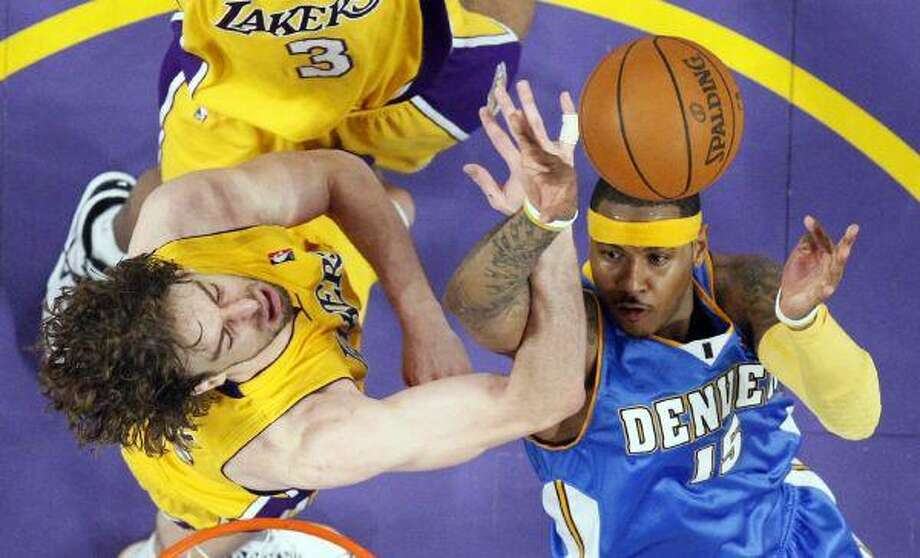 Denver Nuggets forward Carmelo Anthony puts up a shot as Los Angeles Lakers center Pau Gasol defends during the second half of Game 5 of the Western Conference Finals Wednesday. The Lakers won 103-94. / AP