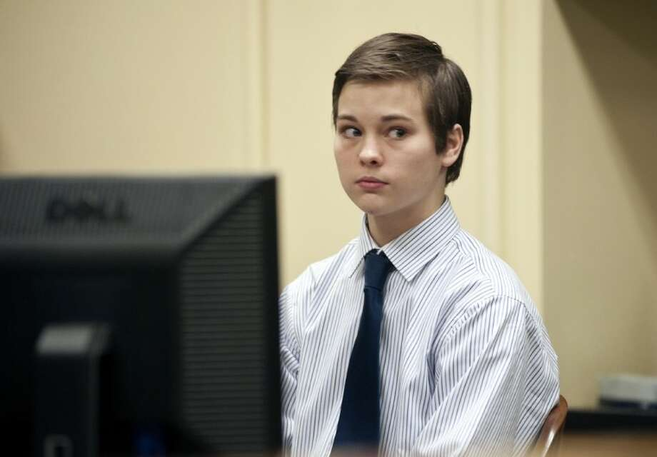 """Mark Nathaniel """"Nate"""" Anderson, 16, of New Chapel Hill, who pleaded guilty to fatally shooting his 19-year-old sister in September 2010, waits for his pleading to begin at the Smith County 241st District Court Thursday. Photo: Sarah A. Miller"""