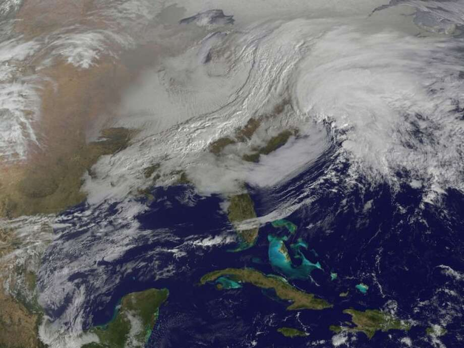 This image released by NASA from NOAA's GOES-13 satellite captured Friday shows a massive winter storm coming together as two low pressure systems merge over the northeast U.S. Photo: Uncredited