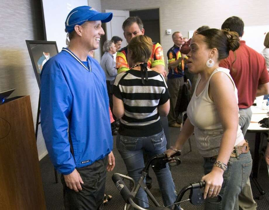 Rob Palmer, captain of BP MS150 Team Anadarko, is thanked for his efforts by a multiple sclerosis patient during Thursday's team kick-off event at Anadarko in The Woodlands. Photo: Staff Photo By Eric S. Swist