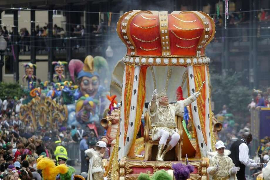 In this March 8, 2011 file photo, Rex, the King of Carnival rides in the Krewe of Rex as he arrives at Canal St. on Mardi Gras day in New Orleans. The Carnival season culminates on Tuesday, Feb. 12, 2013, with street revelry and the pageantry of the Rex and Zulu parades. Photo: Gerald Herbert