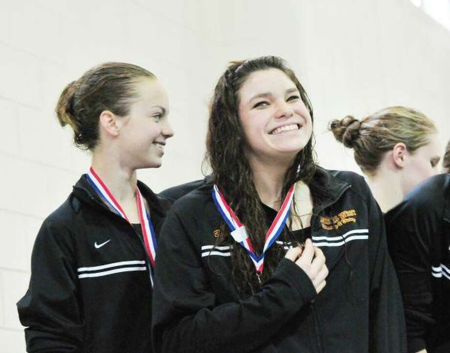 Magnolia West's Bailey Bodway and her Magnolia West teammates celebrate winning the 200 medley relay at the District 18-4A Meet a few weeks back.