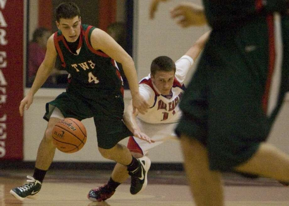 The Woodlands' Hayden Galatas and Oak Ridge's Tanner Doyel battles for a loose ball during Friday night's district game in Oak Ridge. Photo: Staff Photo By Eric S. Swist