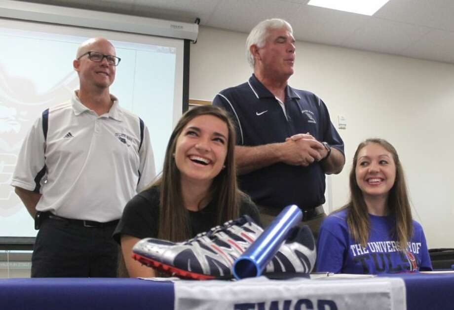 Tierney Price laughs with fellow College Park signee Katie Killeen during a signing day ceremony at College Park High School earlier this year. Price is headed to Vanderbilt University for track and field, while Killeen signed to run cross country with the University of Tulsa. Photo: Jason Fochtman