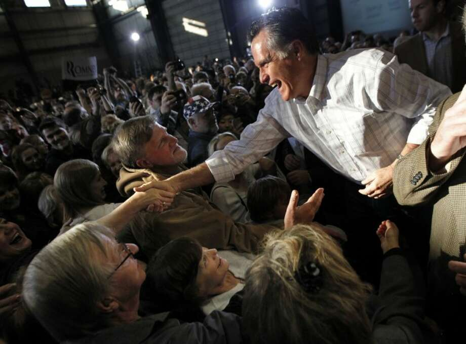 Republican presidential candidate, former Massachusetts Gov. Mitt Romney, greets supporters after speaking at a campaign rally in Colorado Springs, Colo., Saturday. Photo: Gerald Herbert