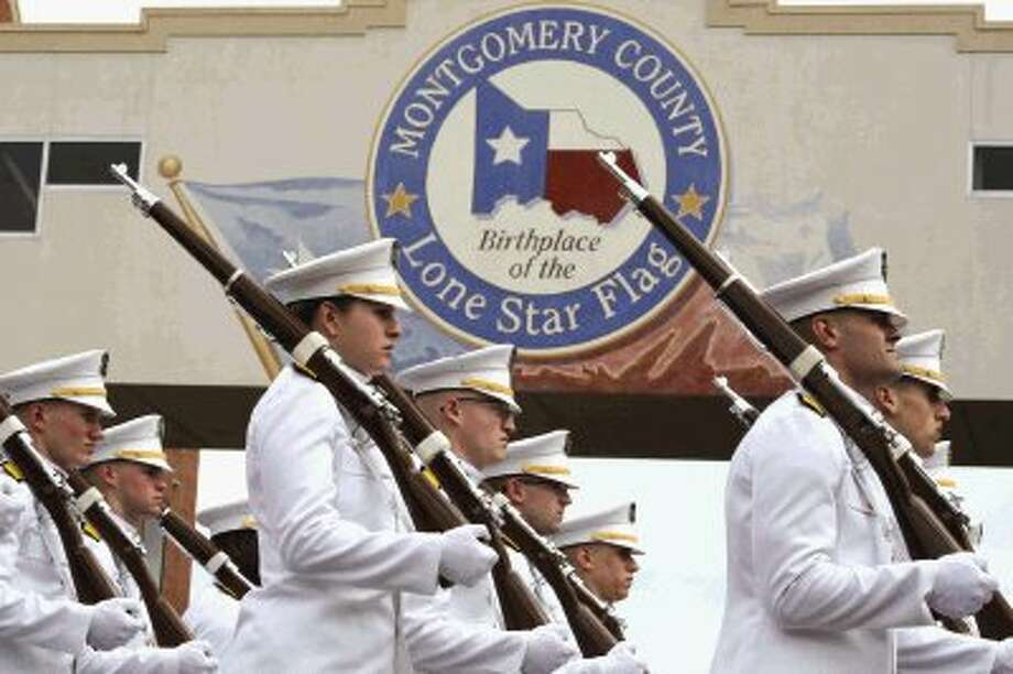 Texas A&M Ross Volunteers, the Honor Guard for the Governer of Texas, lead off the 46th annual Go-Texan Parade in downtown Conroe Saturday afternoon.