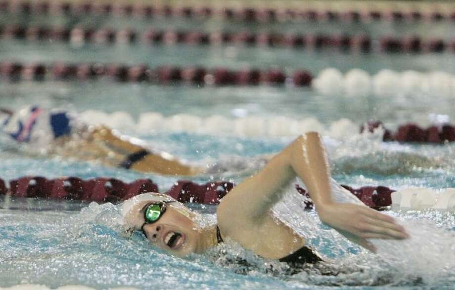 Magnolia West's Mary Katherine Jones helped her team to a first-place finish in the 200-yard freestyle relay and a second-place showing in the 200-yard medley relay in the Region V-4A swimming championships. Magnolia West's girls were second in the team standings. Photo: Staff Photo By Eric Swist