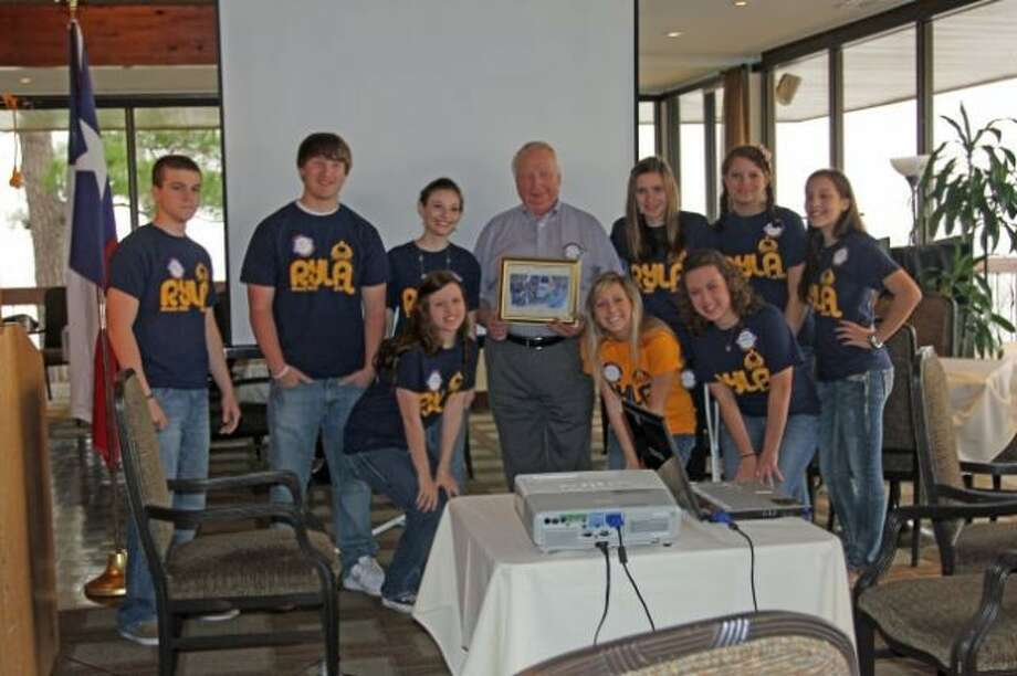 RYLA participants from Willis and Montgomery high schools surround Lake Conroe Rotarian Alfred Anderson and present him with a thank you gift for the use of a van he lent the Lake Conroe Rotary Club to shuttle the teens to RYLA.