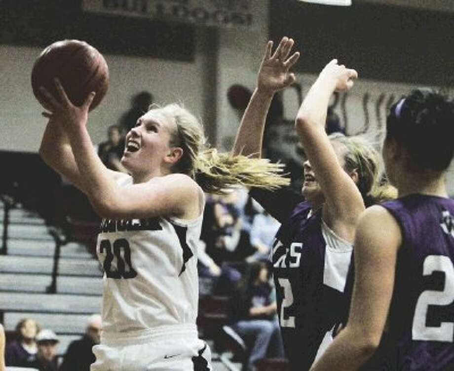 Magnolia's Caitlin Lawrence, left, and the Lady Bulldogs were knocked out in the Class 4A playoffs on Monday night. Georgetown defeated Magnolia 57-32. Photo: Jason Fochtman / The Courier