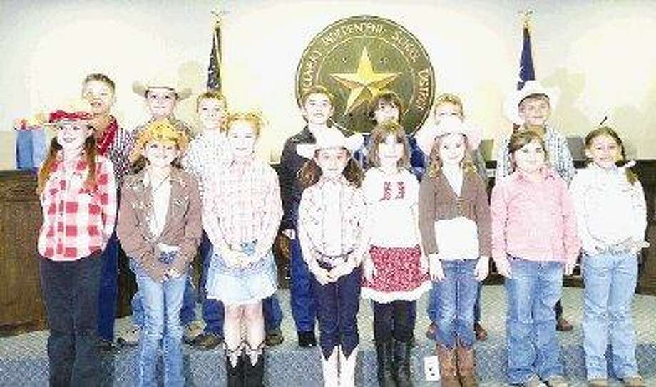 "Second-grade students from Stewart Creek Elementary performed for Montgomery Independent School District trustees as part of ""Go Texan"" month. Participants include Madison Danek, Jayden Erving, Emili Stowe, Taylor Hegemeyer, Marisa Raley, Mikayla Bedford, Madelyn McCulloch, Bayleigh Norman, Logan Montemayor, Colton Whitt, Grayson Vaughn, Landon Perdue, Drake Benton, Dallin Turner and Taylor Brock."