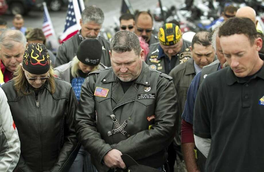 Patriot Guard Riders bow their heads in prayer before leaving for Texas State Cemetery for the funeral of former Navy SEAL Chris Kyle in Austin, Texas, Tuesday, Feb. 12, 2013. Kyle, considered to be the deadliest sniper in U.S. military history, was killed along with a friend on Feb. 2 while at a North Texas gun range. Photo: Ralph Barrera