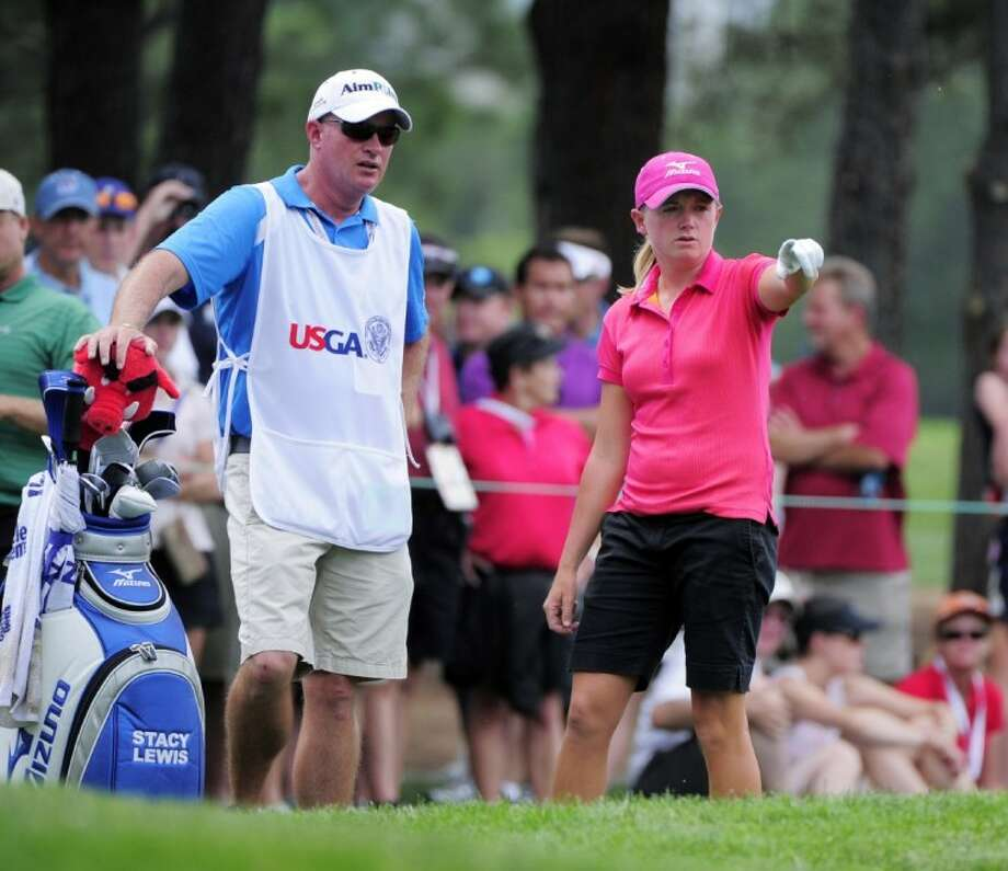 The Woodlands High School grad Stacy Lewis points to the second hole as she talks to her caddy Travis Wilson during the second round of the Women's U.S. Open golf tournament at the Broadmoor Golf Club last summer in Colorado Springs, Colo. Photo: Mark J. Terrill