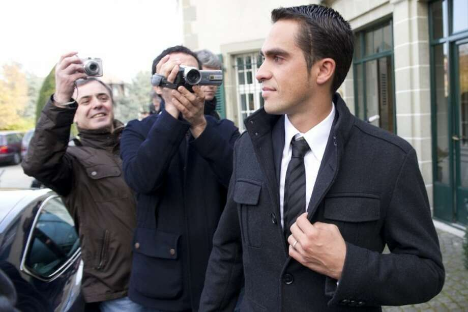 File - In this November 24, 2011 file photo cyclist Alberto Contador, of Spain leaves after the last day of a hearing at the Court of Arbitration for Sport (CAS) in Lausanne, Switzerland. Sport's highest court on Monday has banned Contador for two years after finding the Spanish cyclist guilty of doping, a decision that will strip the 2010 Tour de France champion of his title.The Court of Arbitration for Sport has suspended Contador after rejecting his claim that his positive test for clenbuterol was caused by eating contaminated meat.Contador has continued racing since giving a positive control on a 2010 Tour rest day, and is expected to be stripped of all of his results over the past 17 months including winning the Giro d'Italia last season. Photo: Jean-Christophe Bott