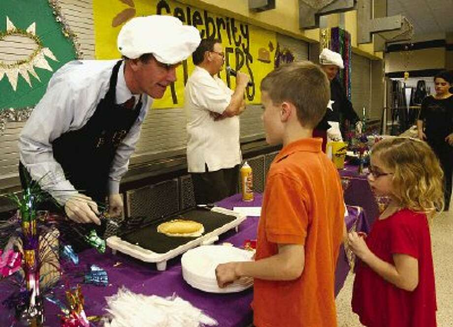 """Conroe Independent School District Superintendent Don Stockton was a celebrity """"flipper"""" at the Golden Girls pancake supper fundraising event Tuesday evening."""