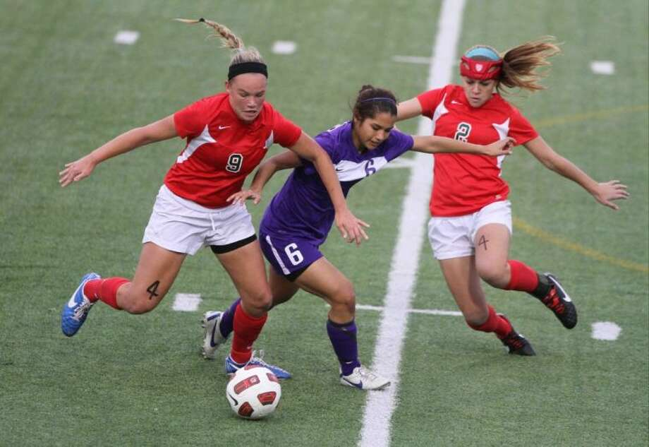 The Woodlands midfielders Grace Piper (9) and Kelly Barbalias compete against Lufkin midfielder Vanessa Luna for the ball during a District 14-5A match Tuesday at Woodforest Bank Stadium in Shenandoah. To view or purchase this photo and others like it, visit HCNpics.com. Photo: Jason Fochtman