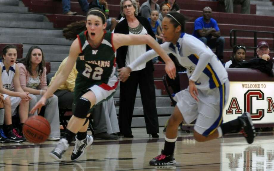 The Woodlands' Paige Bradley drives to the basket against a Pflugerville defender during Tuesday's Region II-5A quarterfinal game in College Station.